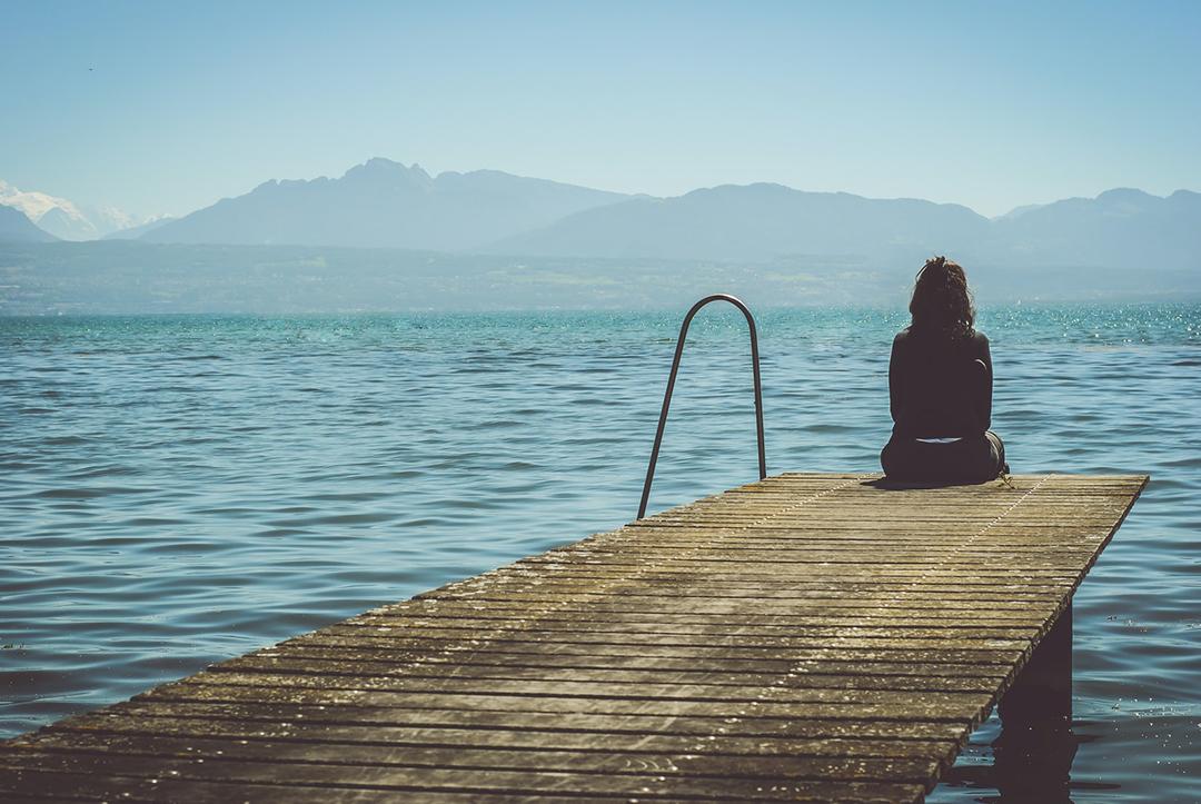 Woman On A Dock Meditating Photo 1476782916354 326ab24c93df Slider