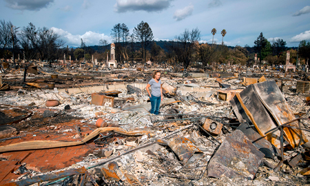 Renee Johnson stands in the middle of her burned home in the Coffey Park area of Santa Rosa, California, on Oct. 20, 2017.